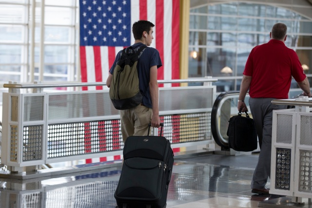 Travelers are seen June 30 at Ronald Reagan Washington National Airport in the Washington suburb of Arlington, Va. (CNS photo/Michael Reynolds, EPA)