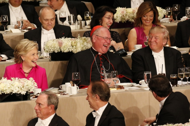 New York Cardinal Timothy M. Dolan shares a light moment with U.S. Democratic presidential nominee Hillary Clinton and Republican presidential nominee Donald Trump during the 71st annual Alfred E. Smith Memorial Foundation Dinner in New York City Oct. 20. (CNS/Gregory A. Shemitz)