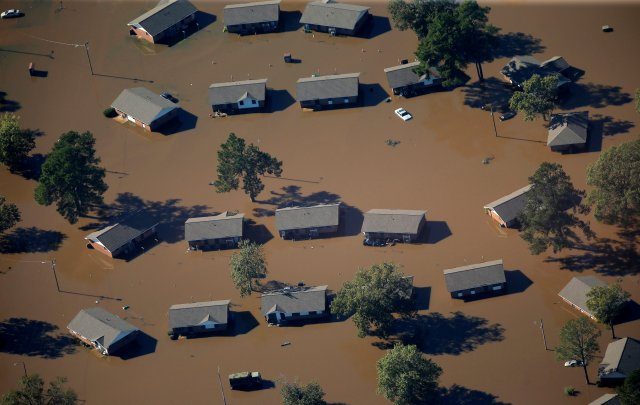 Homes surrounded by floodwaters are seen Oct. 10 in an aerial view of a neighborhood after Hurricane Matthew swept through Lumberton, N.C. (CNS/Reuters)
