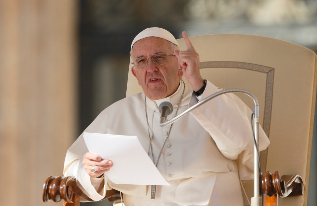 Pope Francis speaks during his general audience in St. Peter's Square at the Vatican Oct. 12. (CNS/Paul Haring)
