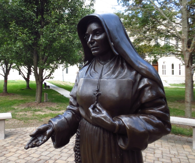 A statue of St. Mother Theodore Guerin graces the courtyard of the Sisters of Providence of St. Mary-of-the-Woods, Ind. The sisters planned a celebration of the 10th anniversary of their congregation's foundress Oct. 15. (CNS/Katie Breidenbach)