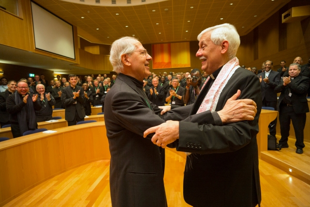 Jesuit Father Arturo Sosa, right, the new superior general of the Society of Jesus, greets the previous superior general, Jesuit Father Adolfo Nicolas, after his election in Rome Oct. 14. Father Sosa, 67, is a member of the Jesuits' Venezuelan province. (CNS/Don Doll, S.J.)