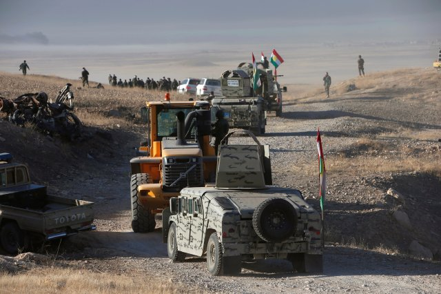 Peshmerga forces advance to attack Islamic State militants Oct. 17 in Mosul, Iraq. This summer, the U.N. said that as the Mosul crisis evolves, up to 13 million people throughout Iraq may need humanitarian aid by the year's end, far larger than the Syrian crisis. (CNS/Reuters)