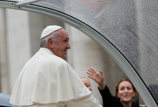 Raindrops are seen on the popemobile as Pope Francis leaves his general audience in St. Peter's Square at the Vatican Oct. 26. (CNS/Paul Haring)