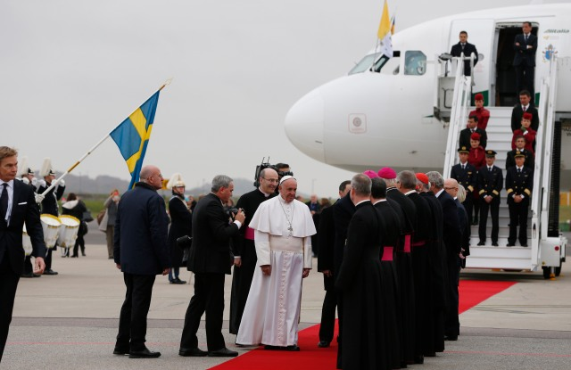 Pope Francis greets people as he arrives at the international airport in Malmo, Sweden, Oct. 31. The pope is making a two-day visit to Sweden to attend events marking the 500th anniversary of the Protestant Reformation. (CNS/Paul Haring)