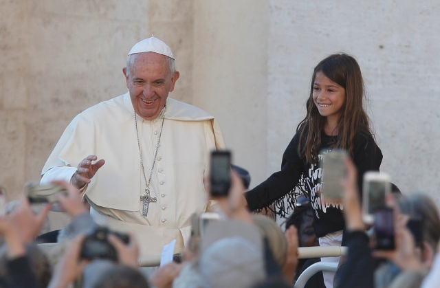 A girl prepares to meet Pope Francis during his general audience in St. Peter's Square at the Vatican Oct. 5. (CNS photo/Paul Haring)