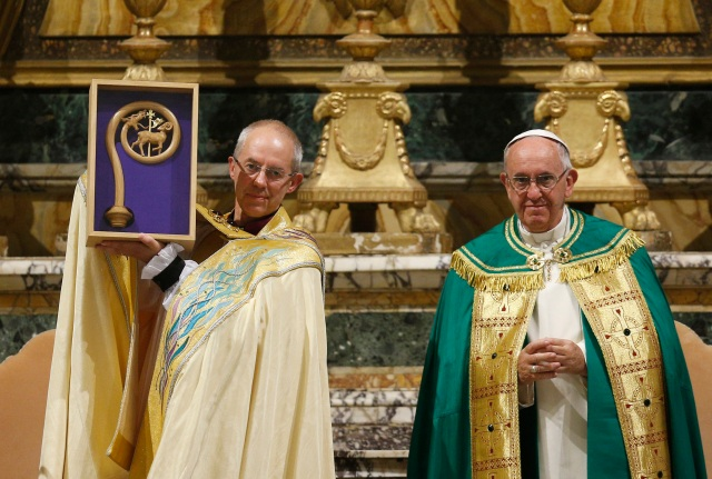 Anglican Archbishop Justin Welby of Canterbury, England, spiritual leader of the Anglican Communion, holds a replica of the staff of St. Gregory the Great given by Pope Francis at a vespers service at the Church of St. Gregory in Rome Oct. 5. (CNS photo/Paul Haring)
