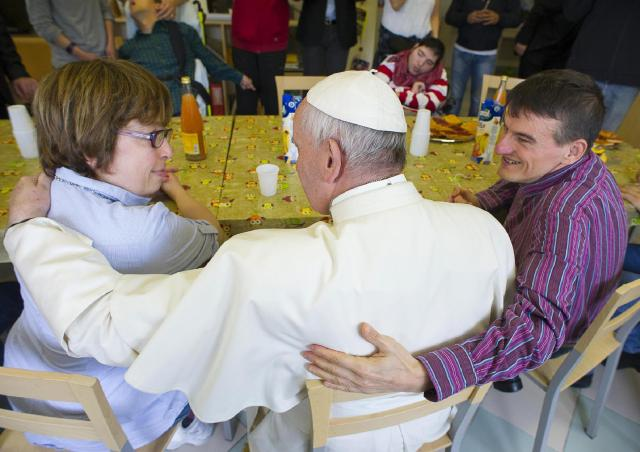"""Pope Francis talks with residents during a May 13 visit at the """"Chicco"""" Community in Ciampino, Italy, for his monthly Mercy Friday in the Jubilee Year of Mercy. The community was founded in 1981 and houses 18 people with intellectual challenges. (CNS/L'Osservatore Romano via Reuters)"""