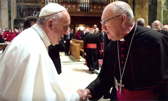 Pope Francis greets Bishop Kevin J. Farrell of Dallas in Washington in September 2015. Pope Francis named the Texas bishop to head the Vatican's new office for laity, family and life. (CNS/courtesy The Texas Catholic)