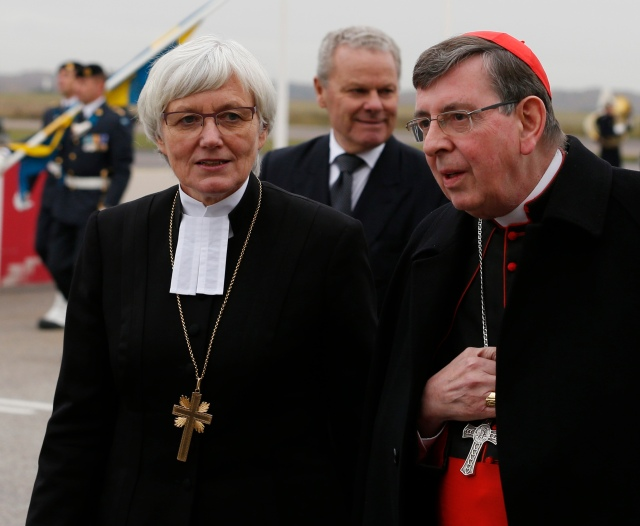 Cardinal Kurt Koch, president of the Pontifical Council for Promoting Christian Unity, is seen with Archbishop Antje Jackelen, primate of the Lutheran Church in Sweden, as Pope Francis arrives Oct. 31 in Malmo, Sweden. (CNS/Paul Haring)