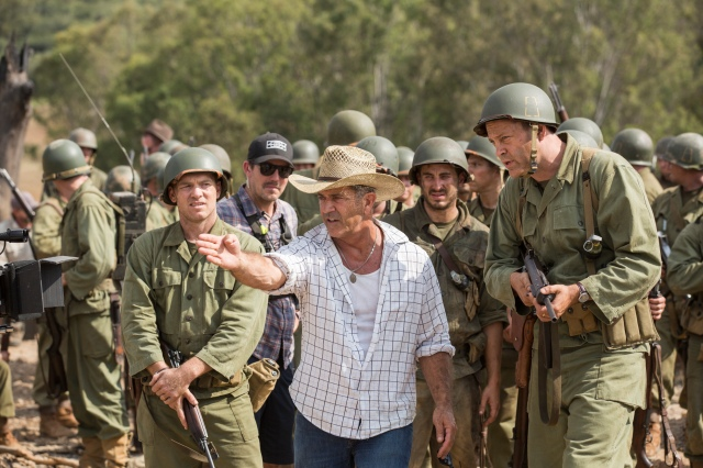"Director Mel Gibson, center, on the set of ""Hacksaw Ridge."" (CNS/Lionsgate)"