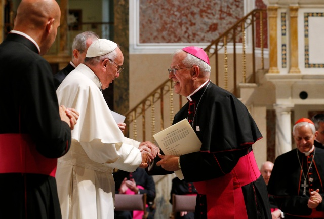 Pope Francis greets Archbishop Joseph E. Kurtz of Louisville, Ky., president of the U.S. Conference of Catholic Bishops, during a meeting with U.S. bishops in the Cathedral of St. Matthew the Apostle in Washington in 2015. Archbishop Kurtz considers the U.S. papal visit to be the biggest highlight of his three-year tenure as president of the bishops' conference. (CNS/Paul Haring)