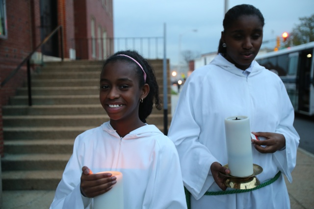 Altar servers stand outside St. Peter Claver Church in Baltimore before Mass Nov. 14. The U.S. bishops' traditional Mass for their annual fall general assembly was celebrated at the historic African-American church. (CNS/Bob Roller)