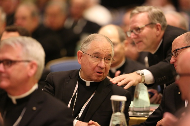 Bishops congratulate Archbishop Jose H. Gomez of Los Angeles after he was elected vice president of the U.S. Conference of Catholic Bishops Nov. 15 during the annual fall general assembly of the USCCB in Baltimore. (CNS/Bob Roller)