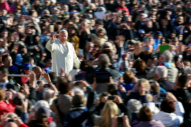 Pope Francis waves as he arrives to lead his general audience in St. Peter's Square Nov. 16. (CNS/Reuters)
