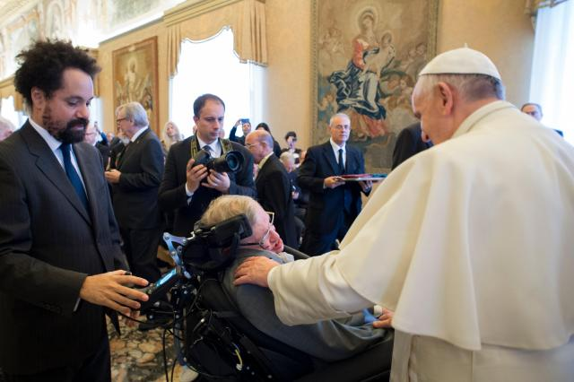 Pope Francis greets British theoretical physicist and cosmologist Stephen Hawking during an audience with participants attending a plenary session of the Pontifical Academy of Sciences at the Vatican Nov. 28. (CNS/L'Osservatore Romano)