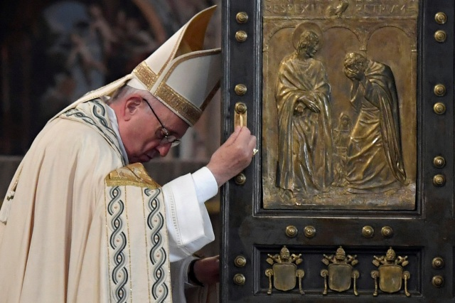Pope Francis closes the Holy Door of St. Peter's Basilica to mark the closing of the jubilee Year of Mercy at the Vatican Nov. 20. (CNS photo/Tiziana Fabi, pool via Reuters)