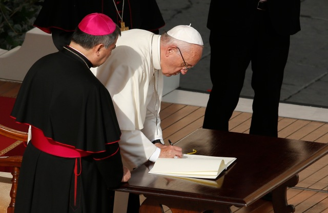 Pope Francis signs his apostolic letter on mercy,