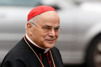 Portuguese Cardinal Jose Saraiva Martins arrives for a general congregation meeting at the Vatican in this March 7, 2013, file photo. (CNS/Paul Haring)