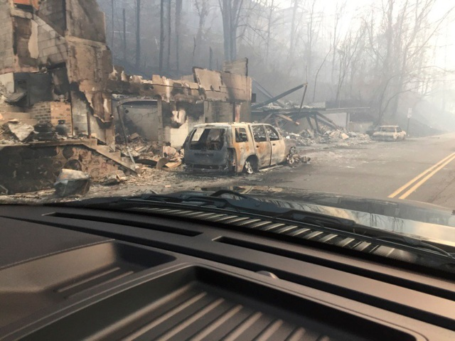 Burned buildings and cars are seen Dec. 1 in Gatlinburg, Tenn., in the aftermath of wildfires. (CNS/courtesy Tennessee Highway Patrol, via Reuters)