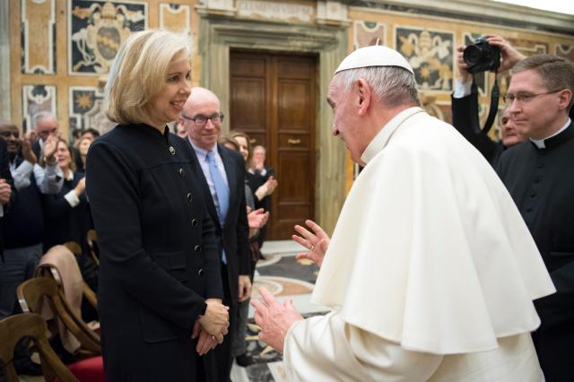 Pope Francis greets Nancy Gibbs, editorial director of Time Inc. News Group, and Alan Murray (behind her), editor-in-chief of Fortune, during an audience with business leaders at the Vatican Dec. 3. The business leaders were taking part in the Fortune-Time Global Forum in Rome. (CNS/L'Osservatore Romano)