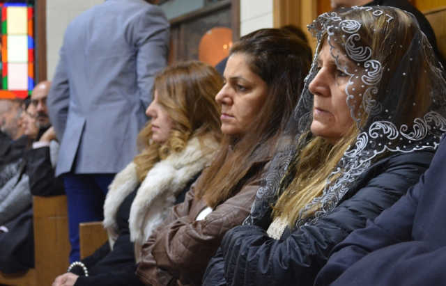 Fairuz Rassam, a long-time Chicago resident, sent for her Iraqi sisters, Firaz and Victoria, so they could escape the conflict in Iraq. They are seen at Mass Dec. 4 at St. Ephrem Chaldean Catholic Church in Chicago. (CNS/Simone Orendain)