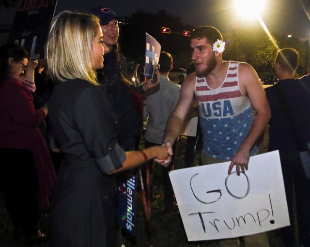 Shannon Kelly, a protester demonstrating against U.S. President-elect Donald Trump, shakes hands with Trump supporter Ben Kilgore after a long discussion about the billionaire's qualifications in Tallahassee, Fla. (CNS/Reuters)
