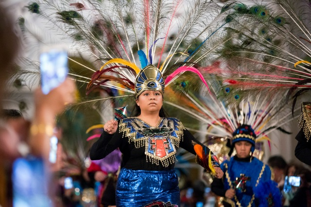 Dancers dressed in traditional Aztec clothing re-enact the miracle of the roses during a Dec. 10 Mass in honor of Our Lady of Guadalupe at the Basilica of the National Shrine of the Immaculate Conception in Washington. The U.S. Catholic bishops declared her Dec. 12 feast as a day of prayer and solidarity with families of immigrants. (CNS/Jaclyn Lippelmann, Catholic Standard)