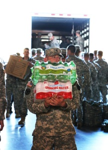 A member of the National Guard in Tennessee Nov. 29 unloads bottled water donated to Sacred Heart Cathedral in Knoxville, Tenn., for victims of wildfires. (CNS photo/Bill Brewer, The East Tennessee Catholic)