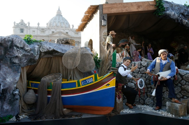 A boat representing migrants is pictured in the Nativity scene in St. Peter's Square at the Vatican Dec. 9. (CNS photo/Paul Haring)