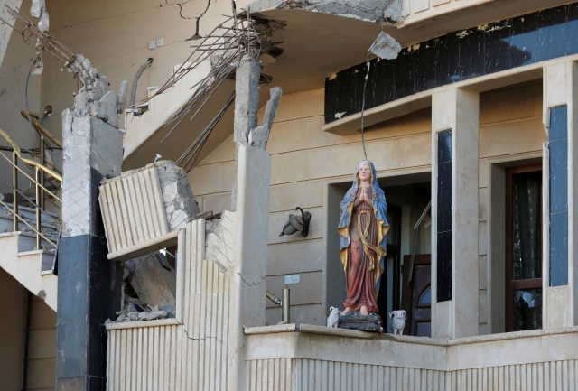 A damaged statue of Mary is seen in a church in Qaraqosh, Iraq, Nov. 25. (CNS photo/Goran Tomasevic, Reuters)