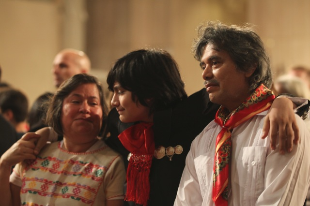 "Samuel Catalan, middle, holds on to his mother, Alejandra Catalan, and father, Francisco Catalan, at a Dec. 10 Mass for the feast of Our Lady of Guadalupe at the Basilica of the National Shrine of the Immaculate Conception in Washington. Washington Auxiliary Bishop Mario E. Dorsonville told the largely immigrant crowd that the Catholic Church stands with them in ""these difficult moments"" of uncertainty about immigration matters in the country. (CNS photo/Rhina Guidos)"
