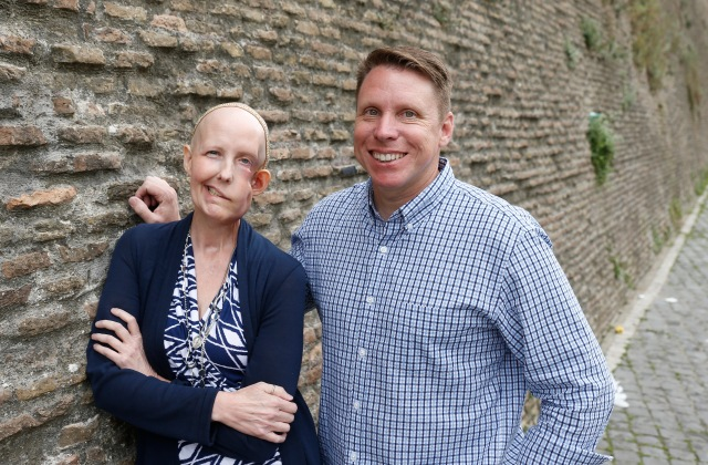 Cheryl Tobin, who had stage IV cancer, is pictured with her husband Jim along the wall at the Vatican May 11. Cheryl Tobin died in her sleep New Year's Eve. She was 48. (CNS photo/Paul Haring)