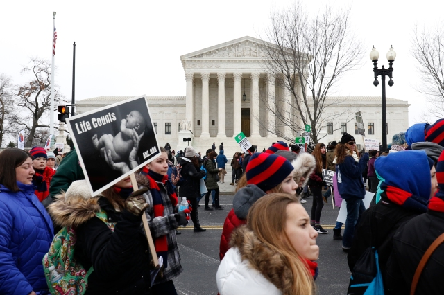 Pro-life advocates walk past the Supreme Court building during the March for Life in Washington Jan. 22, 2016. This year's march is set for Jan. 27, starting near the Washington Monument. (CNS/Gregory A. Shemitz)