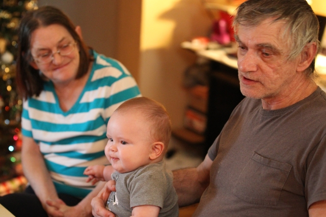 Tonya and Chuck Cooper hold their grandson, Benjamin, 7 months, in their Newark, Ohio, home. The Coopers are leaders in the Newark Think Tank on Poverty. (CNS/Dennis Sadowski)