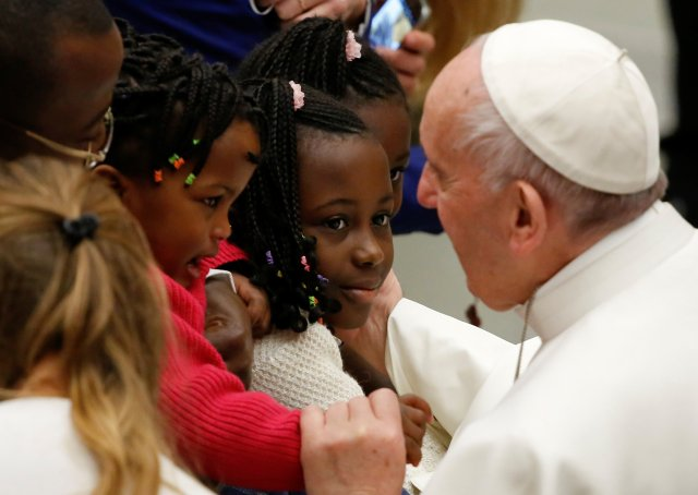 Pope Francis greets young people during his weekly audience Jan. 4 in Paul VI hall at the Vatican. (CNS/Reuters)