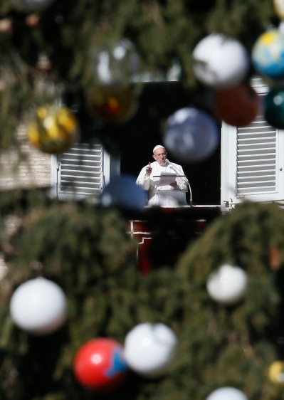 Pope Francis leads the Angelus from his studio overlooking St. Peter's Square at the Vatican Jan. 6, the feast of the Epiphany. (CNS/Paul Haring)