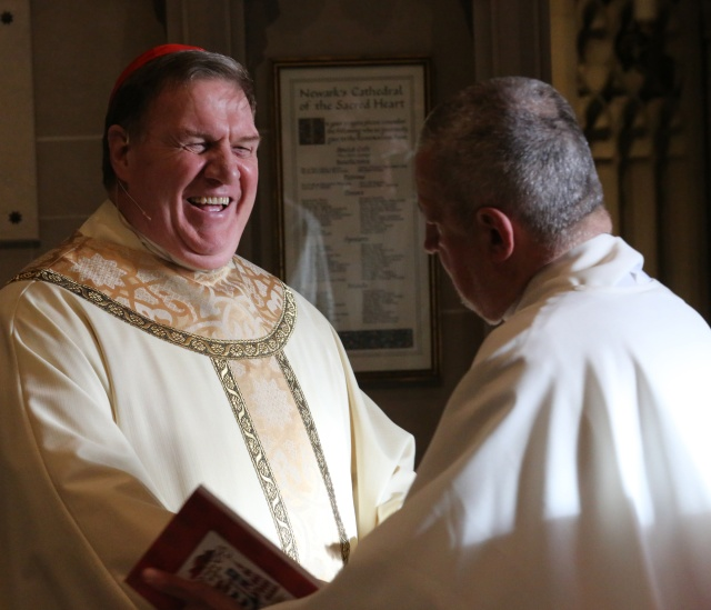 Cardinal Joseph W. Tobin smiles as he greets a clergyman before his Jan. 6 installation Mass at the Cathedral Basilica of the Sacred Heart in Newark, N.J. (CNS/Bob Roller)