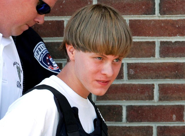 Police lead suspected shooter Dylann Roof into the courthouse in 2015 in Shelby, N.C. (CNS/Reuters)