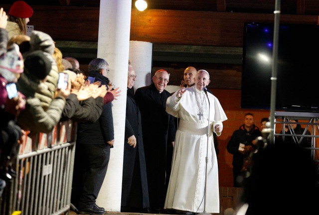 Pope Francis greets the crowd outside the church after celebrating Mass at the parish of St. Mary in the Setteville neighborhood of Rome Jan. 15. (CNS/Paul Haring)
