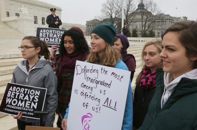 Mary Solitario, 21, center, joins a pro-life demonstration outside the U.S. Supreme Court prior to the Women's March on Washington Jan. 21. (CNS/Bob Roller)