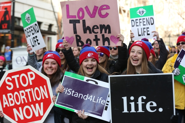 Students from the Diocese of Lansing, Mich., holds signs during the annual March for Life in Washington Jan. 27. (CNS/Jaclyn Lippelmann, Catholic Standard)