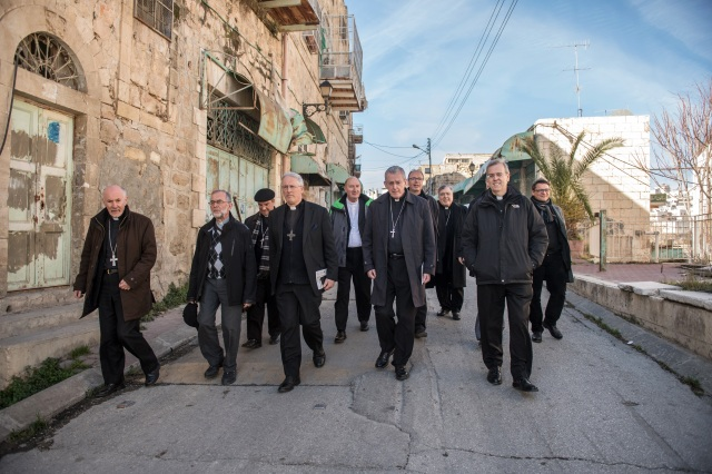 Bishops from the U.S, Canada and Europe walk through a street Jan. 16 in Hebron, West Bank. (CNS photo/Marcin Mazur, Bishops' Conference of England and Wales)