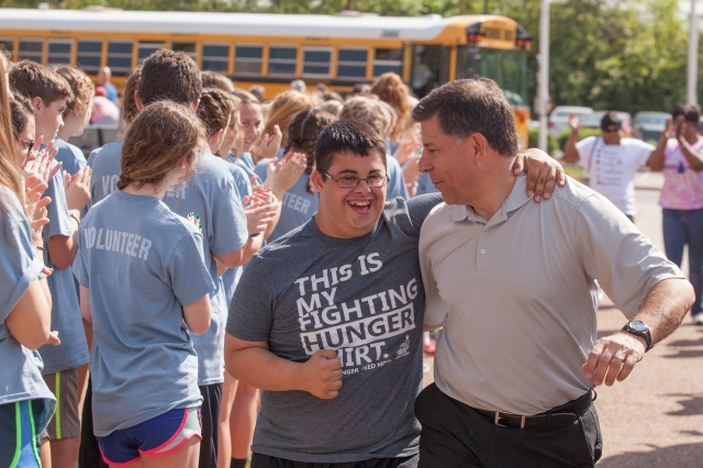 Andrew Donaldson hugs his father, Randy, on the way to a Special Olympics competition last year at a Catholic high school in Nashville, Tenn. (CNS/Rick Musacchio, Tennessee Register)