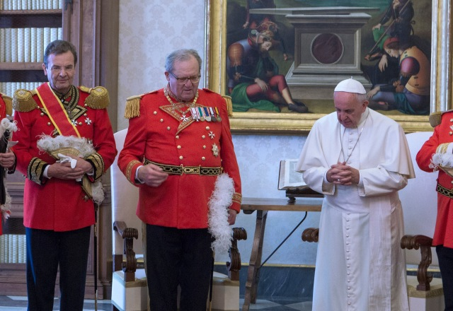 Pope Francis prays with Albrecht von Boeselager, left, and Fra Matthew Festing during a private audience with members of the Knights of Malta at the Vatican in a 2016 file photo. (CNS photo/pool)