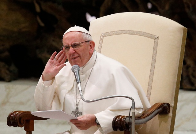 Pope Francis puts his hand to his ear after asking for a response from the crowd during his general audience in Paul VI hall at the Vatican Feb. 1. (CNS/Paul Haring)