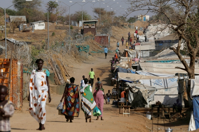 Internally displaced people walk on a road close to the outer perimeter of a United Nations mission Feb. 16 outside Juba, South Sudan. (CNS/Reuters)