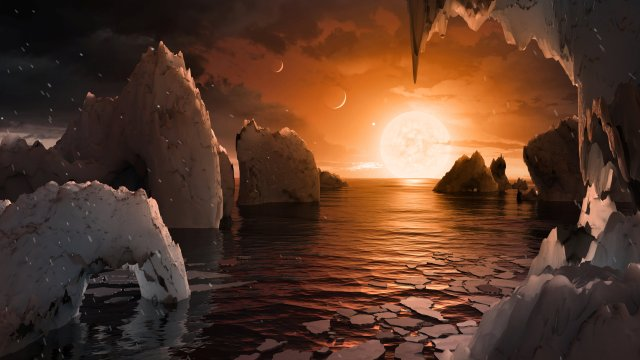 An artist's depiction shows the possible surface of TRAPPIST-1f, on one of seven newly discovered planets in the TRAPPIST-1 system. (CNS/NASA via Reuters)