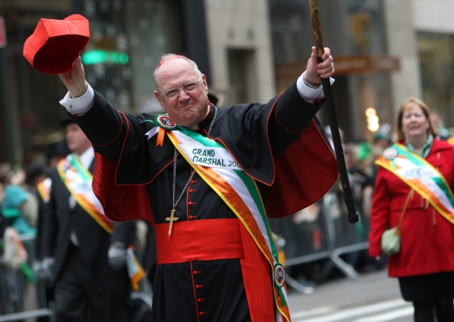 New York Cardinal Timothy M. Dolan waves to the crowd while serving as grand marshal of the St. Patrick's Day Parade in New York City in 2015. (CNS/Gregory A. Shemitz)
