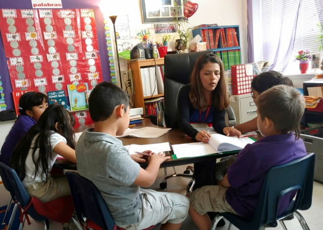 Teacher Maria Dominguez works with students at Rodriguez Elementary School in Austin, Texas. (CNS photo/courtesy Maria Dominguez)